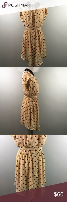 """Dahlia Fashion Co UK Swan Print Becca Dress Dahlia Fashion Co UK Swan Print Becca Dress  New with tags, good condition. Because of the delicate nature of the fabric, there may be small snags. Tag says Cream, but the color is more beige/blush/apricot.  Approximate Measurements: Bust 36"""" Waist 27"""" Center Back Length 34"""" (longer in front)  Tags: ModCloth Peter Pan Collar Wear to Work Animal Print Shirt Dress Button Skirt  ✅Bundle discounts ✅ Will consider reasonable offers ✉️Please let me know…"""