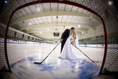 perfect wedding picture for all the hockey couples out there.