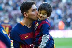 Lionel Messi of FC Barcelona kisses his son Thiago ahead of the La Liga match between FC Barcelona and Real Sociedad de Futbol at Camp Nou on November 28, 2015 in Barcelona, Catalonia.