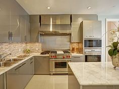Take a Tour of Yolanda Foster's Gorgeous New Post-Split Condo (PHOTOS) | THE KITCHEN | While her old kitchen housed a refrigerator pristine enough to inspire its own Twitter account, this one sure ain't bad, either. The white marbled countertops and built-in stainless steel appliances are a cook's dream.