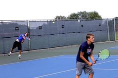 Nick Matthews, left, fires a serve while Tim Matthews, right, both of Huxley, awaits a return during the Iowa Games youth tennis round robin tournament Thursday, July 14, 2016. A majority of other Iowa Games events are slated around Ames for the weekend with opening ceremonies scheduled to begin at 5 p.m today in parking lot S7, directly east of Jack Trice Stadium. Photo by Dan Mika/Ames Tribune