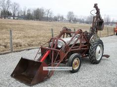 Image from http://twentywheels.com/imgs/a/a/z/v/b/1950_ford_8n_tractor_with_front_loader__rear_backhoe_5_lgw.jpg.