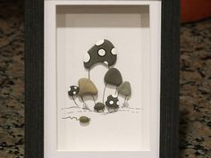 Stayin Together Hand picked beach pebbles and art by me! Comes in a black wooden frame with glass but you can frame it as you wish! Is ready for wall or table top display! Frame measures about 6x8 and is matted to 5.5x3.5 Thanks for looking!:)