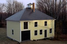 Big yellow barn- charcoal slate roof. Roof inspiration.