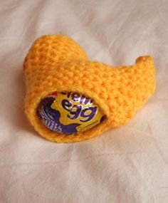 Knitted chick cosy with chocolate egg