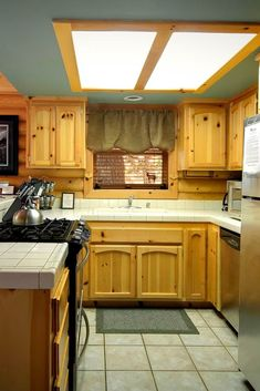 Knotty Pine Cabinets, Stainless Steel Appliances, And Log Cabin Coziness In Big  Bear Lake