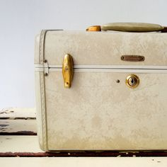 Had one like this and we stored our Strawberry Shortcake dolls in it. Vintage train case
