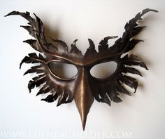 Griffin leather mask, hand-painted in chocolate brown and bronze, gryphon. $115.00, via Etsy.