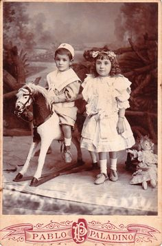 :::::::::: Antique Photograph ::::::::::  Siblings posed with toys.  Pablo Paladino