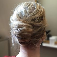 Messy Blonde French Roll-messy texture, wispy layers near the face