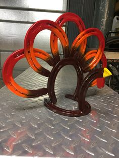 Handmade horseshoe turkey is Welded out of new horseshoes. It is really cool and is sure to be the talk of the day at Thanksgiving dinner. It is designed to be a napkin holder centerpiece but looks great anywhere! I know you will have as much fun showing him off as I did making him
