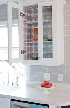 "I've always liked the glass front cabinets and wall paper is such a cute idea to make it ""pretty"""