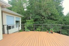 G Christianson Construction built this 2nd story deck with cable railing system for out clients to replace their existing rotten deck.