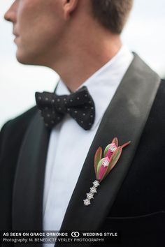 #Contemporary #handpainted #hotpink #succulent #groom #boutonniere with #bling. Designed by #C2Mdesigns, #JohnOrtonFlowersandEvents