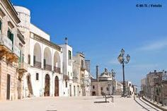 The gorgeous city of Brindisi in the Apulia region will take you back in time, with its tiny streets, ancient buildings, wild nature and gorgeous beaches. Brindisi Italy, Puglia Italy, Ancient Buildings, Small Group Tours, Italian Villa, Sustainable Tourism, White City, Street View, World
