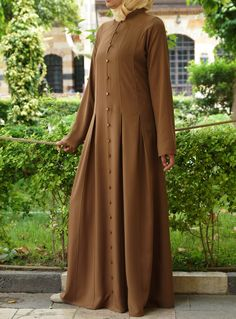 Pleated Abaya Save Color: Toffee This dignified and modest pleated abaya is perfect for anything- from work to a casual sisters' get-together, and even more formal occasions. Made from soft, lightweight rayon, it's great for both the office and parties! Abaya Fashion, Muslim Fashion, Modest Fashion, Fashion Dresses, Hijab Dress, Hijab Outfit, Abaya Designs, Islamic Clothing, Mode Hijab
