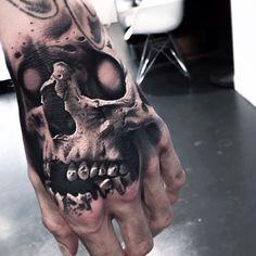 skull tattoo by Levi Barnett