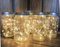 "These amazing ""firefly jars"" are the perfect centerpiece for your country wedding. Use jars of varying sizes to add some interest to your table!"