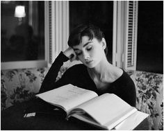 Audrey Hepburn. Reading in black and white.
