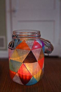 """Another DIY fabulous inexpensive wedding favor idea... use glue and tissue paper to make """"stained glass"""" jars to use for candles, pencil holders, or whatever. Use lots of colors, or stick to your wedding colors... have fun with it!"""
