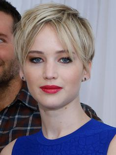 To copy Jennifer Lawrence's lived-in pixie, add a bit of texturizing spray to the hair and scrunch with your fingertips.