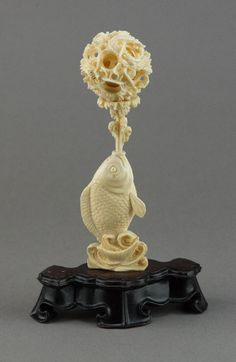 Description: Chinese ivory statue, fish statue base supporting layered intricately carved magic ball, on custom stand. H: 14 cm, D: cm, 86 grams with stand. Pictures On String, Felt Pictures, Ivory Elephant, Statue Base, Asian Artwork, Wood Vase, Stone Carving, String Art, Horns