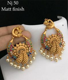 Jewelry OFF! Beautiful matte gold chaandbali in peacock design. Designer gold jewelry@ Plz Whatasp 91 9908278128 to order. Gold Jhumka Earrings, Indian Jewelry Earrings, Jewelry Design Earrings, Gold Earrings Designs, Gold Jewellery Design, Antique Earrings, Gold Jewelry, Fine Jewelry, Handmade Jewellery
