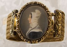 Finely executed, Georgian portrait miniature on ivory depicting a lady in mourning. Note the mourning jewelry she is wearing. The miniature is decorated with an ornate chases work frame and attached to a medium brown hair work bracelet. Setting is pinchbeck.