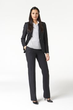This is a pant suit and accompanied with a blouse and dark, closed toe pumps.