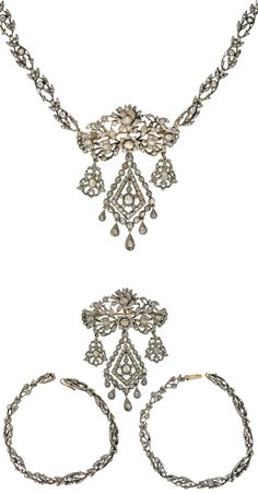 Georgian Rose cut diamond pin and necklace set, France, c.1780s. Silver and old Rose Cut diamonds, resembling flowing vines and delicate leaves with flowers in bloom. A very versatile piece. Worn as a necklace (top), it fastens together at a push clasp in the back, and hooks onto either side of the large centerpiece in the middle. The back of the center link attaches to a gold bar pin, allowing it to be detached from the necklace and worn on its own as a pin with two bracelets (bottom) —LB…