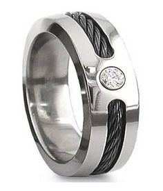 In an unusual combination of grit and glamour, this 7mm titanium wedding ring easily transitions from a casual setting to a dressed-up affair. It features a black cable inset and a single cubic zirconium gemstone set into a polished titanium band. Men who want a ring that is truly unique and fashionable will love the versatility of this lightweight and comfortable ring. $35.95