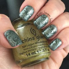 It ain't easy being green . And holo! This is China Glaze Take a Hike topped with Golden Enchantment. The pattern is stamped using silver Konad stamping polish and my 5-01 UberChic beauty plate. My topcoat is always HKGirl from Glisten&Glow. #GlistenandGlow ❤️.    #diynails #nailart #polishaddict  #naturalnails #fallnailart #fallnails #fallnails #nailstamping