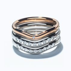 Elsa Peretti® band rings in 18k rose gold and platinum with diamonds.