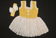 Crocheted daisy dress with matching headband on Etsy, $45.00