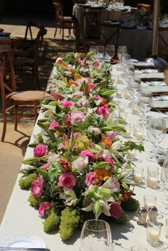 Beautiful custom floral and fruit garland for head table in the courtyard of Mayacama. This is a great spring and summer look for your wine country wedding. Venue: MayacamaEvents.com |  Flowers: GreenValleyGrower.com