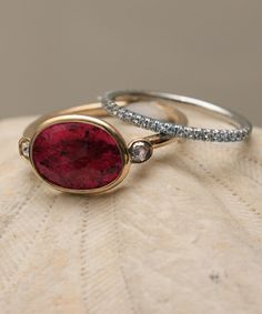 Ruby, Diamond and yellow gold ring by Aroc Urtu, shown with a diamond band.