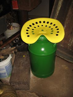 tractor seat on top pf a milk can - my dad made something like this - mine is in all red