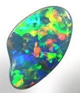 Palette Pattern in Opal. Many colors are placed in the whole face of the stone.