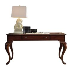 An elegant addition to your living room or home office, this 1-drawer writing desk showcases mahogany veneers and cabriole legs.  Pr...