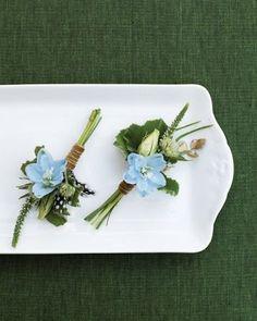 Light-blue delphinium, lisianthus buds, geranium foliage, veronica tips, and button ferns #weddingflowers
