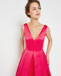 I really like this bright pink gown. It reminds me of an Audrey Hepburn ensemble.