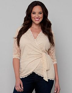 Be the star in your own romance novel with our Juliet Wrap Top. This full functional wrap top beautifully envelops your curves and hides any tummy troubles with a flattering cinch detail across your midriff. With delicate scalloping along the neckline and hem, you will simply fall in love with this romantic top. sonsi.com