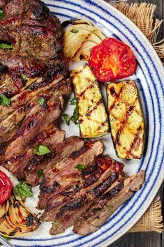 The ultimate grilled lamb recipe! Mediterranean garlic-herb marinated lamb leg with mint pesto. Plus a full menu of Mediterranean sides and salads to serve!