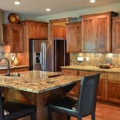 white quartersawn oak kitchens with shabby white islands and granite | White Oak Residence Highland Builders LLC