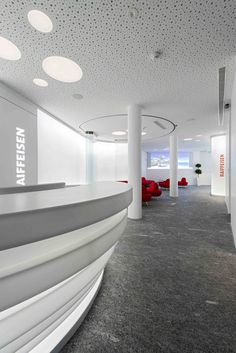 Raiffeisen Bank's offices. Interior design made with HI-MACS® solid surface.