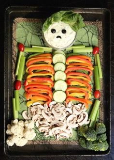 Skeleton Veggie Tray - Easy & healthy Halloween Idea. Perfect recipe for Halloween parties! #Halloween #Healthy #HealthyRecipes #Fall #FallRecipes