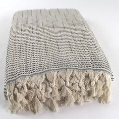 This large luxury throw is made of 100% cotton. It perfect over your couch, on your bed, or an on-the-go blanket for the beach and other outings. - hand woven with gorgeous fringe detailing  Size: 180 x 220cm