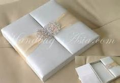 Ivory silk wedding box with large crystal clasp now also available as a box. Fine silk and luxury shiny rhinestones make this box a new eye catcher on the wedding market. Wedding Boxes, Gold Wedding, Diy Wedding, Wedding Events, Weddings, Wedding Ideas, Invitation Design, Invitation Cards, Invitation Ideas
