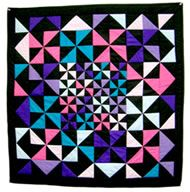 "Amish quilt. Did you know that each color represents a different thing? You can usually tell the Amish quilts apart from other quilts because of the colors. They are usually bound in black because that ""binds"" the other colors together."