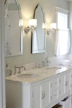 Sinks with Venetian mirrors and pretty sconces ~